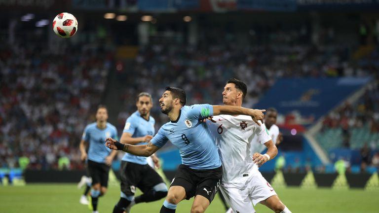 Suarez battles for possession against Jose Fonte