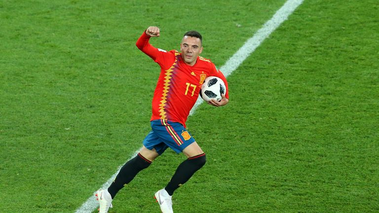 Iago Aspas scored a late equaliser for Spain to secure top spot in Group B