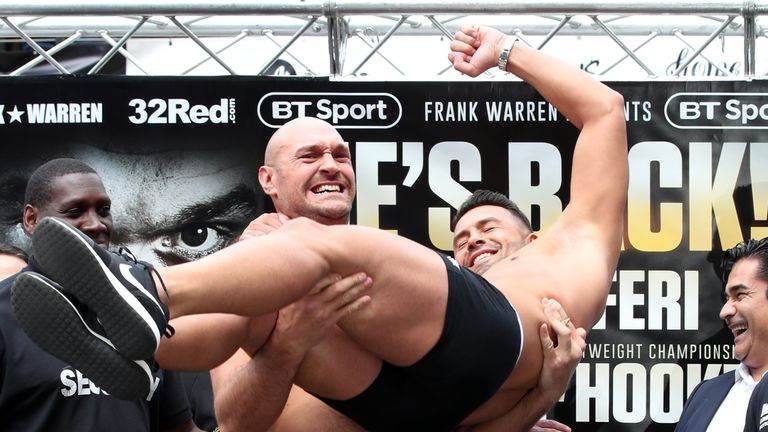 Tyson Fury lifts opponent Sefer Seferi during the weigh-in