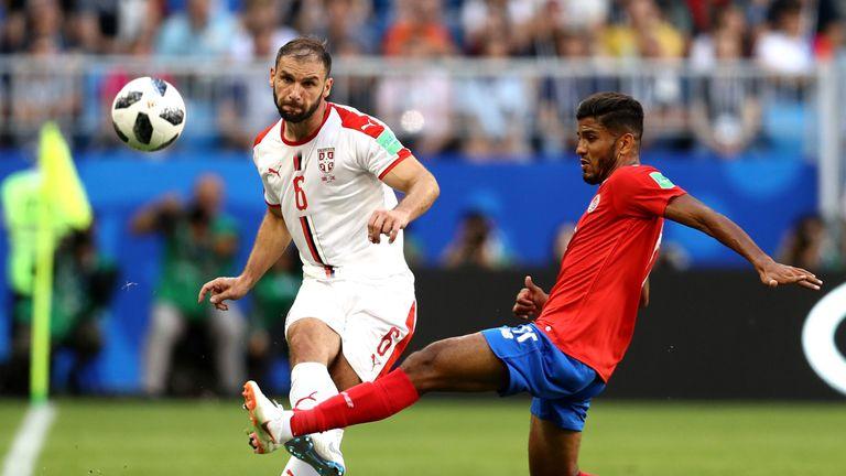 Branislav Ivanovic and Johan Venegas in action during the group E match at Samara Arena