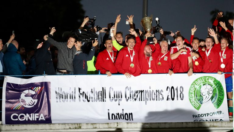 Karpatalya players celebrate with the trophy after victory over Northern Cyprus in the final of the CONIFA World Football Cup at Enfield (Con Chronis/CONIFA)
