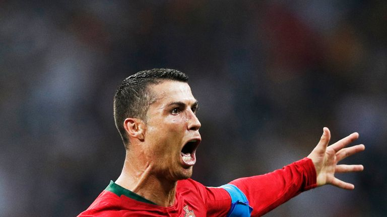 Cristiano Ronaldo celebrates scoring his third goal during the Russia 2018 World Cup Group B football match between Portugal and Spain at the Fisht Stadium in Sochi on June 15, 2018