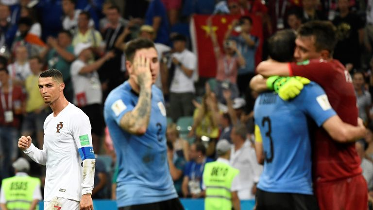 Cristiano Ronaldo looks on as Uruguay celebrate at the final whistle