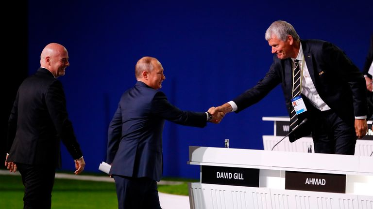 President of Russia, Vladimir Putin, shakes hands with FIFA Vice President Gill