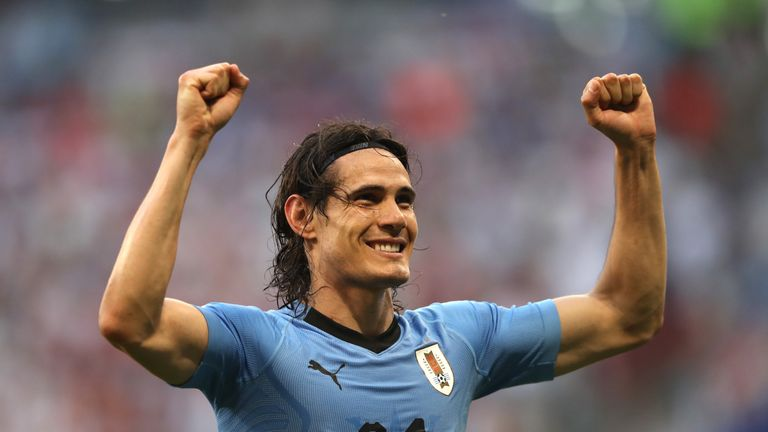 Edinson Cavani celebrates after Uruguay top group A with a 3-0 win over Russia