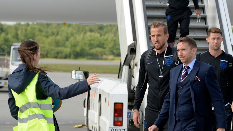 Harry Kane and Gary Cahill step onto the tarmac at St Petersburg's Pulkovo airport on Tuesday