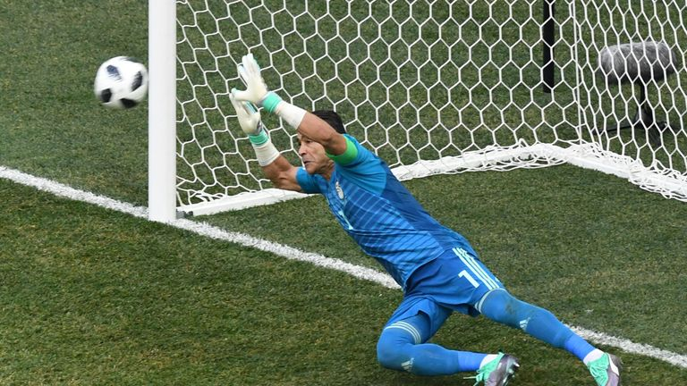 Essam El-Hadary, the oldest ever player to compete in the World Cup, saves a penalty from Fahad Al-Muwallad