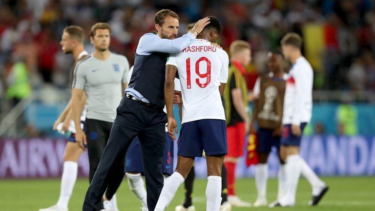 Gareth Southgate consoles Marcus Rashford after the 1-0 loss to Belgium