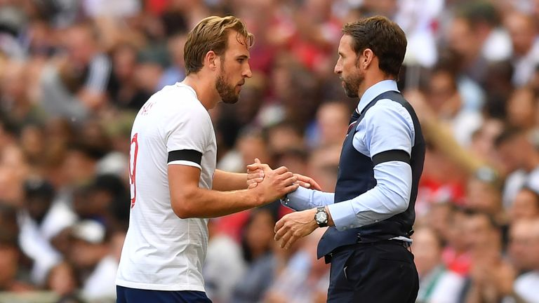 Harry Kane and Gareth Southgate embrace during England's match against Nigeria at Wembley