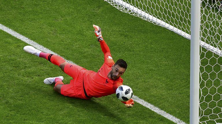 Hugo Lloris saves a deflected shot on goal