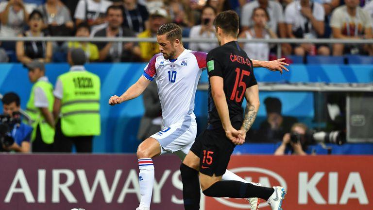 Gylfi Sigurdsson (L) vies with Croatia's defender Duje Caleta at World Cup