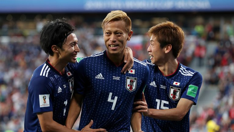 Keisuke Honda scored his fourth goal at a World Cup finals to secure Japan a 2-2 draw with Senegal