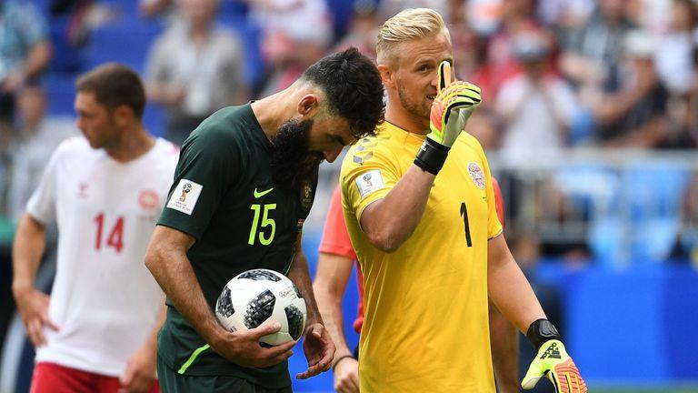 Kasper Schmeichel gestures as Mile Jedinak prepares to take a penalty