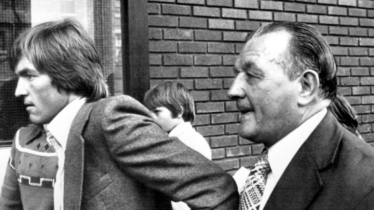 Dalglish (left) with Bob Paisley upon signing for Liverpool