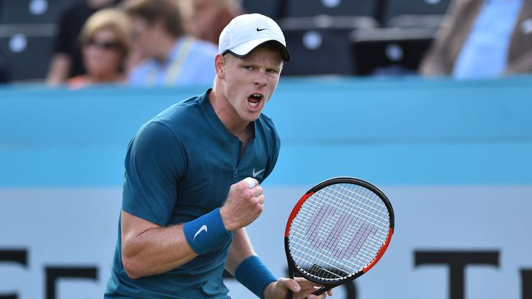 Britain's Kyle Edmund reacts to America's Ryan Harrison during his first round men's singles match at the ATP Queen's Club Championships tennis tournament in west London on June 19, 2018