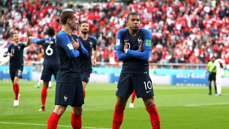 Kylian Mbappe celebrates scoring the opening goal of the game with team-mate Antoine Griezmann