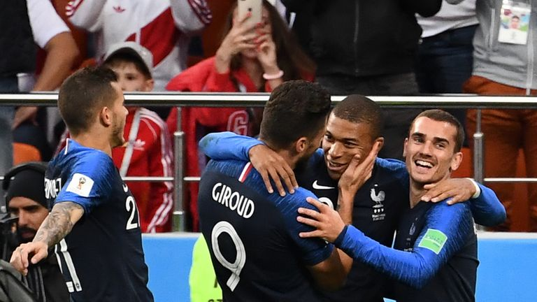 Kylian Mbappe celebrates with Giroud after scoring the game's only goal