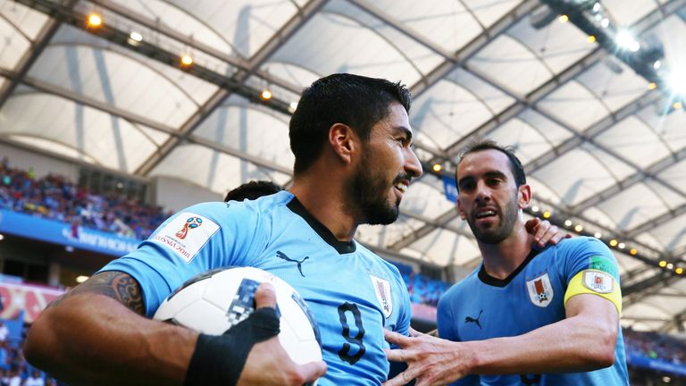 Luis Suarez celebrates after scoring his team's first goal