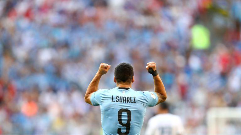 Luis Suarez celebrates after scoring Uruguay's first goal