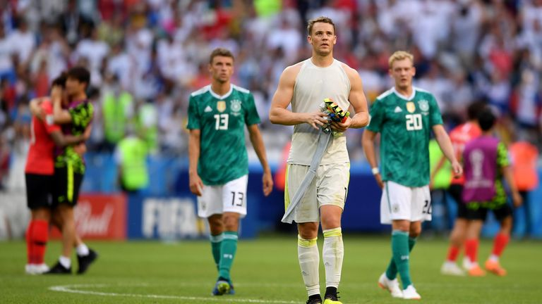 Manuel Neuer,  Thomas Mueller and Julian Brandt leaves the pitch following Germany's elimination from the 2018 World Cup