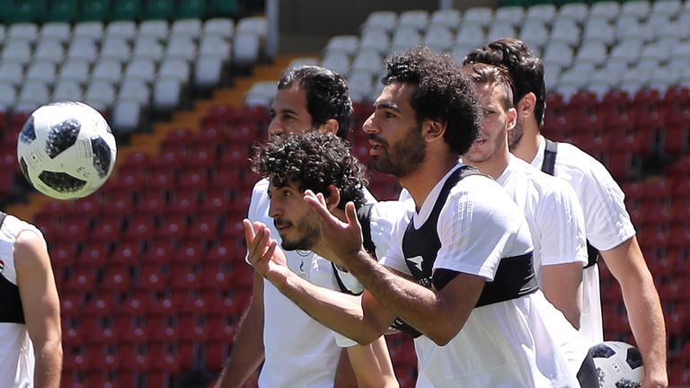Egypt's forward Mohamed Salah (R) is seen during a training at the Akhmat Arena stadium in Grozny on June 13, 2018, ahead of the Russia 2018 World Cup football tournament. (Photo by KARIM JAAFAR / AFP) (Photo credit should read KARIM JAAFAR/AFP/Getty Images)
