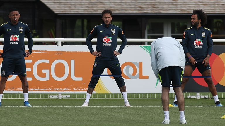 Marcelo (right) linked up with Neymar at Brazil's training camp in England this week