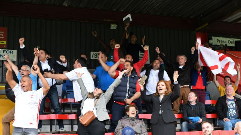 Northern Cyprus supporters celebrate in the stands at Carshalton's Colston Avenue ground