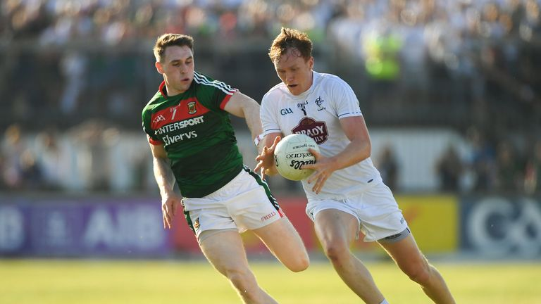 Paul Cribbin of Kildare in action against Paddy Durcan of Mayo