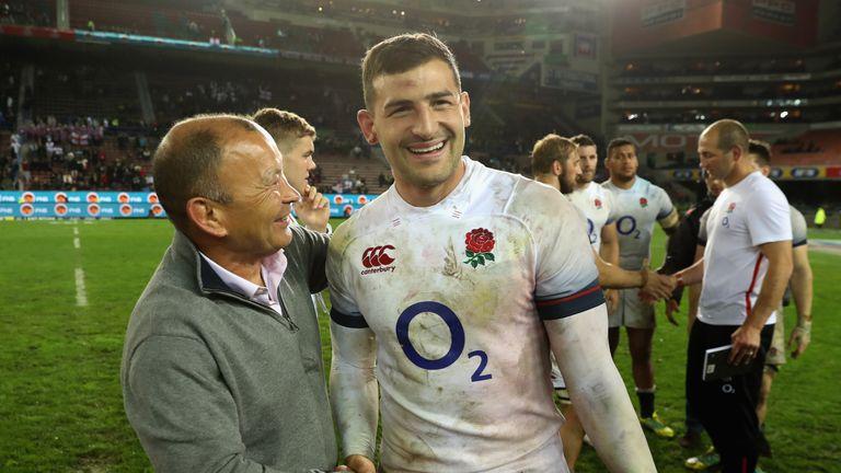 England head coach Eddie Jones congratulates wing Jonny May on another eye-catching display.