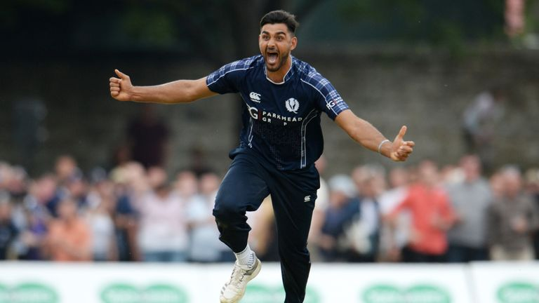Safyaan Sharif celebrates after taking the final wicket of Mark Wood in Scotland's stunning win