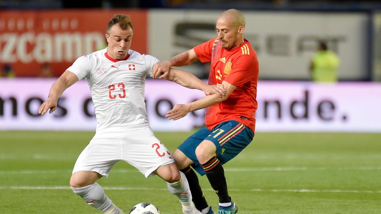 Shaqiri battles with Spain's David Silva during a World Cup warm-up match