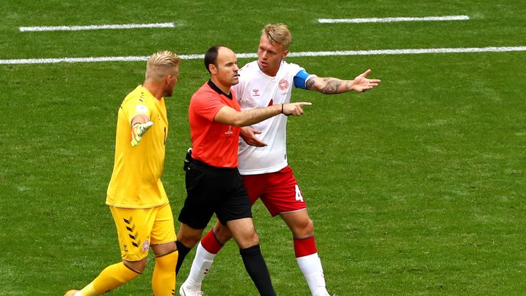 Denmark duo Simon Kjaer and Kasper Schmeichel dispute the decision to award Australia with a penalty