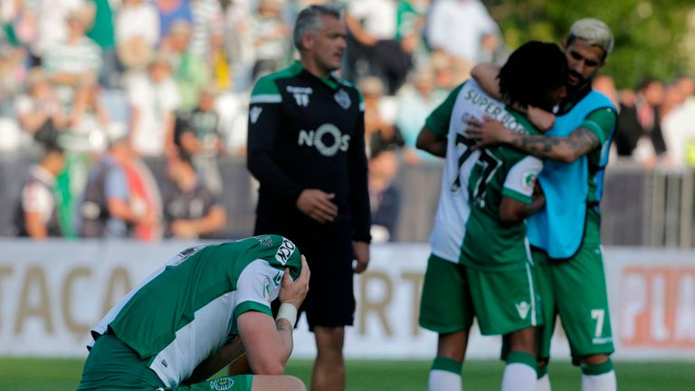 Sporting Lisbon players show their dejection after their cup final defeat