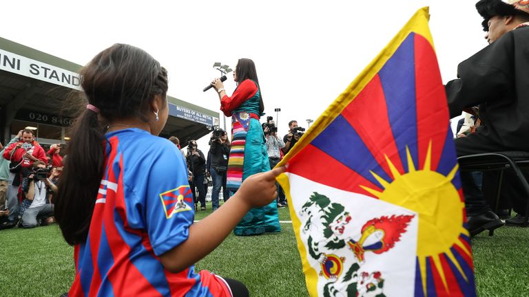 LONDON, ENGLAND - MAY 31: A Tibet fan watches a singer at the Opening Ceremony of the CONIFA World Football Cup 2018, Barawa v Tamil Eelam at Bromley on May 31, 2018 in London, England. (Photo by Con Chronis/CONIFA)