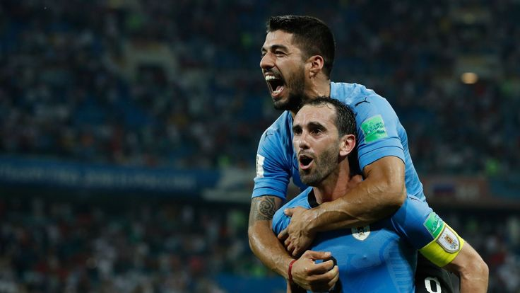Luis Suarez and Diego Godin celebrate in Uruguay's win over Portugal at the 2018 World Cup
