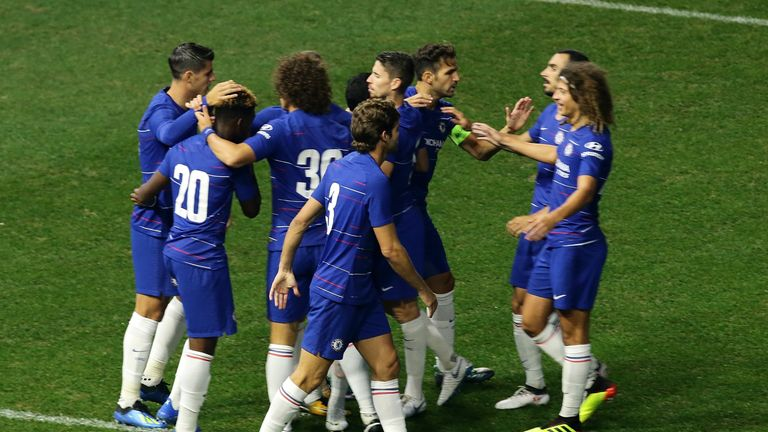 Chelsea players celebrate Pedro's opening goal