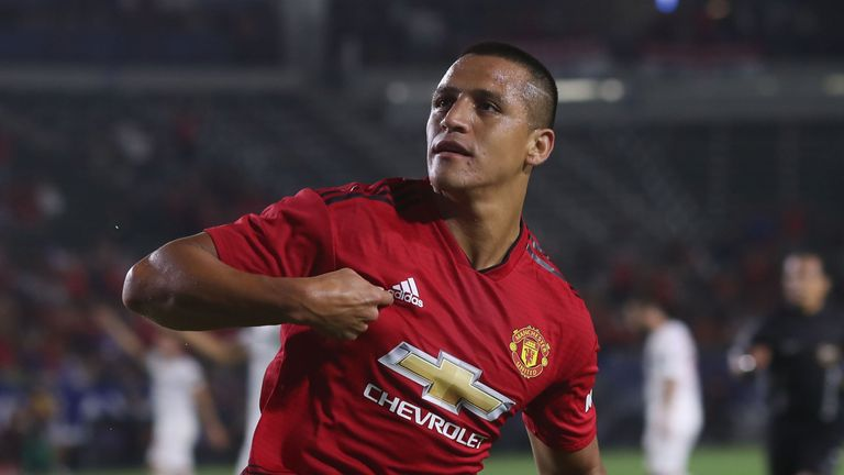 Alexis Sanchez wheels away in celebration after putting United ahead