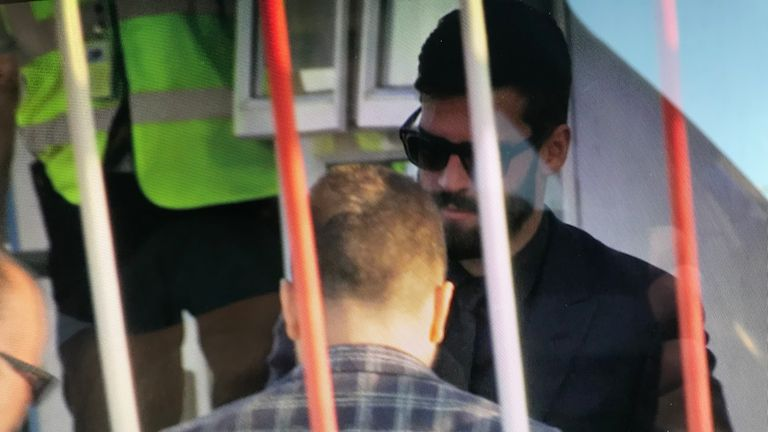 Alisson leaving John Lennon Airport after undergoing a medical at Liverpool