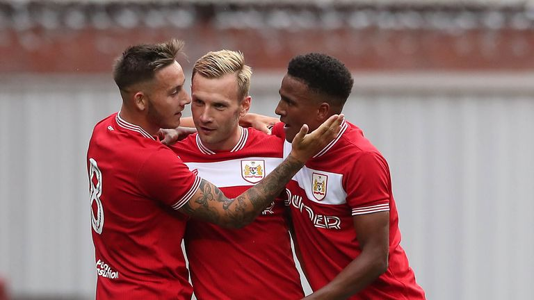 Bristol City's Andreas Weimann (centre) celebrates scoring his side's first goal of the game with Josh Brownhill (left) during a pre-season friendly match at Ashton Gate