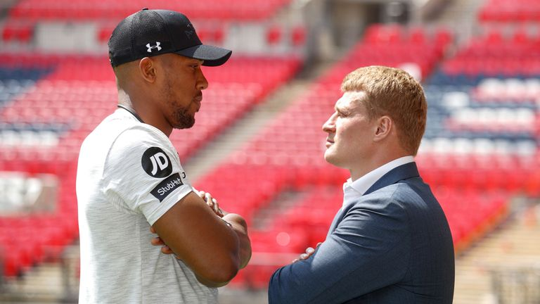 Anthony Joshua and Alexander Povetkin pose for photographs during a press conference at Wembley Stadium