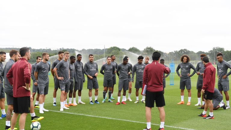 Arsenal players receive instructions from their new coaching staff