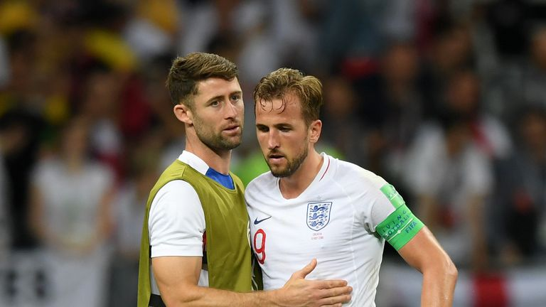 Cahill consoles Harry Kane after the semi-final defeat to Croatia