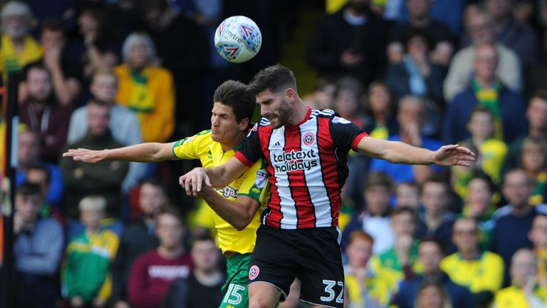 Ched Evans (R) signs for Fleetwood