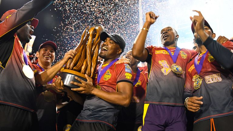 Darren and Dwayne Bravo celebrate with the trophy after Trinbago Knight Riders' win over St Kitts and Nevis Patriots