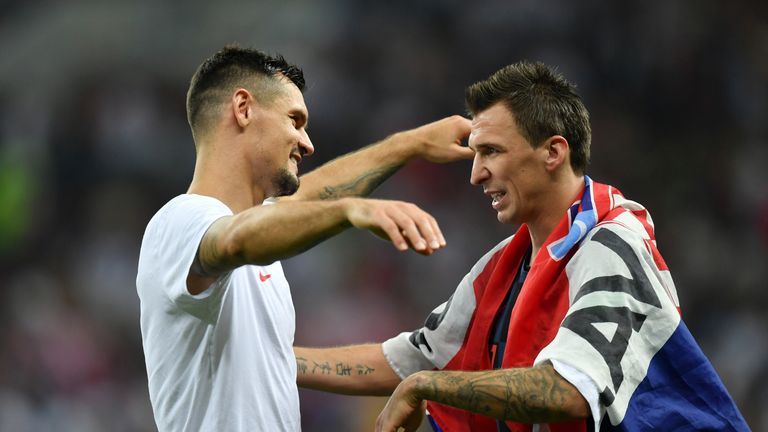 Lovren celebrates with match winner Mario Mandzukic after extra-time goal fires Croatia into World Cup final