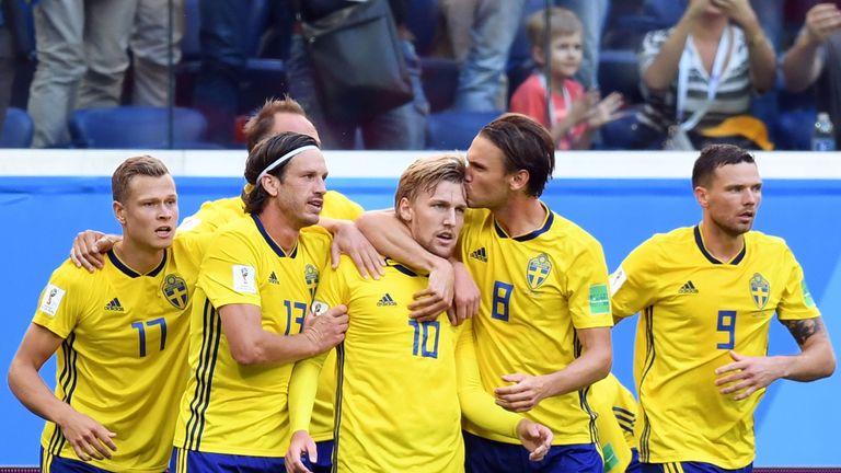 Emil Forsberg (C) celebrates his goal with team-mates