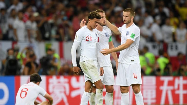 Dele Alli, Harry Kane and Eric Dier stand dejected after England's loss to Croatia