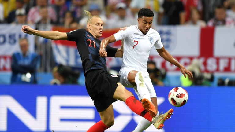 Jesse Lingard vies with possession with Domagoj Vida