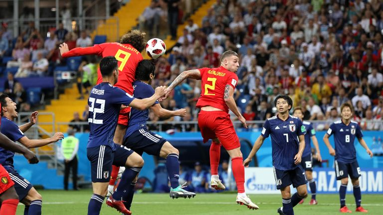 Marouane Fellaini rises to head Belgium level during a breathless second half