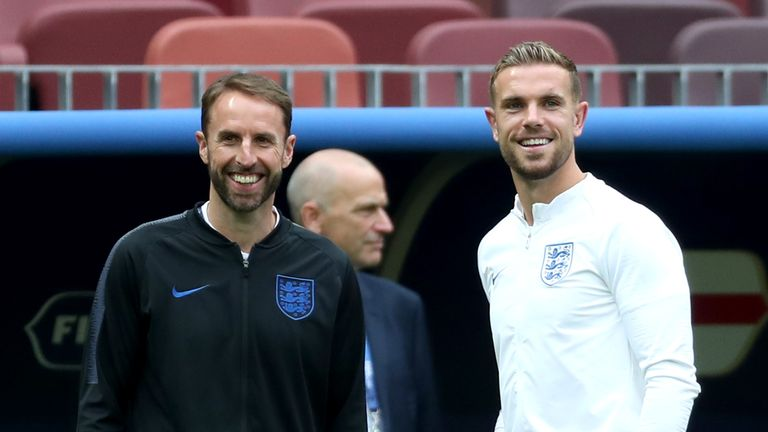 Gareth Southgate, Manager of England speaks with Jordan Henderson of England during a pitch inspection during the England Press Conference at the Luzhniki Stadium on July 10, 2018 in Moscow, Russia
